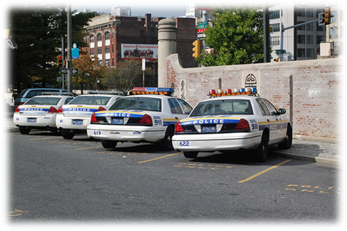Philadelphia Police Departments cars line the street